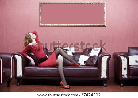 Portrait of woman in red dress in interior