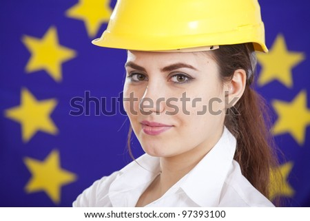 portrait of woman in safety helmet over european union flag - stock photo