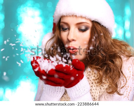 Portrait of woman in scarf and gloves on bright blue background - stock photo