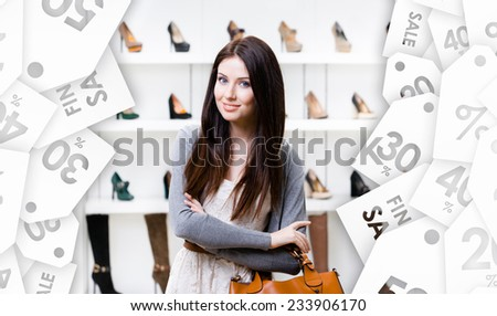 Portrait of woman in shopping center in the section of female pumps, seasonal sale. Concept of consumerism and stylish purchase - stock photo