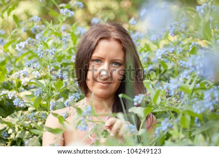portrait of  woman in spring blossoming garden