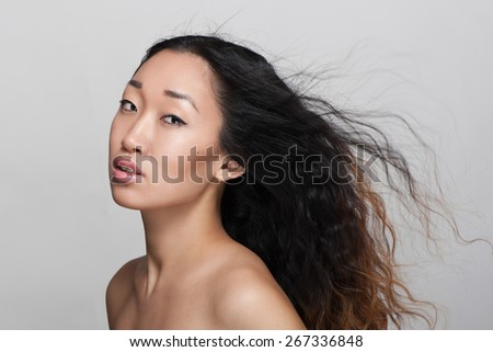 Portrait of woman in studio - stock photo