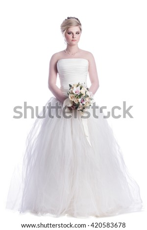 Portrait of woman in wedding dress on white background - stock photo