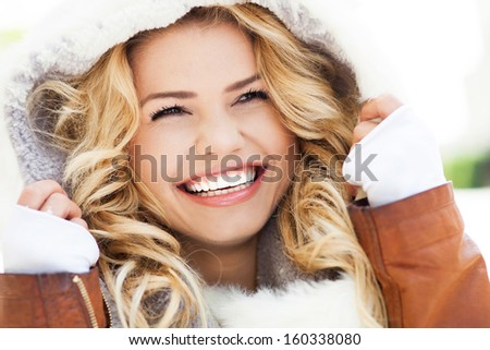 Portrait of woman in winter clothing - stock photo