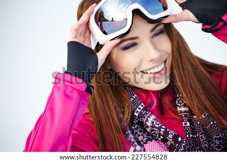 Portrait of woman in winter scenery - stock photo