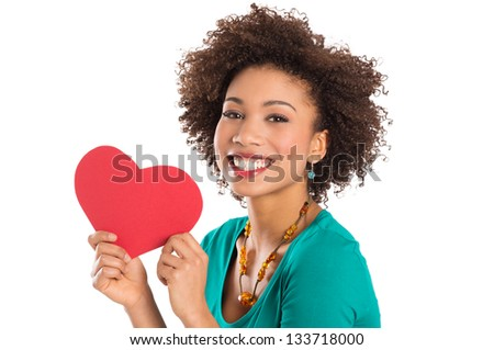 Portrait Of Woman Isolated Holding Heart Shape Over White Background - stock photo