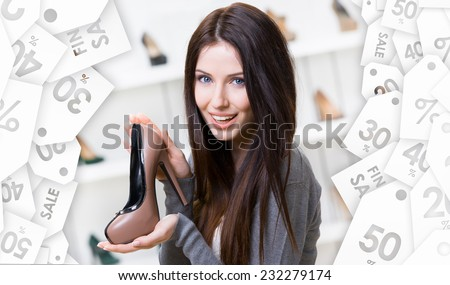 Portrait of woman keeping coffee-colored leather shoe in shopping center. Christmas sale - stock photo