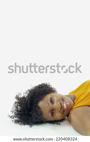 Portrait of woman laying on floor - stock photo
