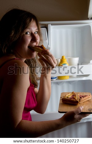 portrait of woman near by fridge at night