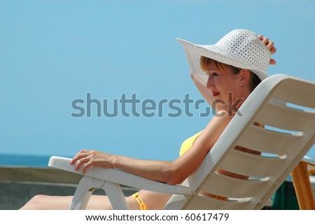 Portrait of woman on chaise longue