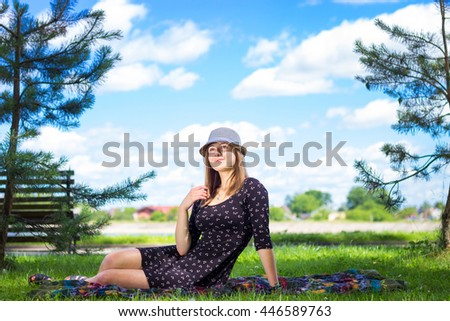 Portrait of  woman on green background. Pretty girl at outdoors on summer day. Nature environment background.