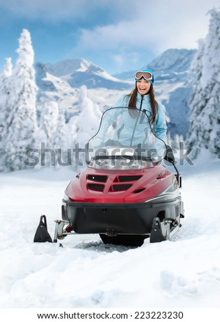 Portrait of woman on snowmobile. Concept of snow sport and healthy lifestyle - stock photo