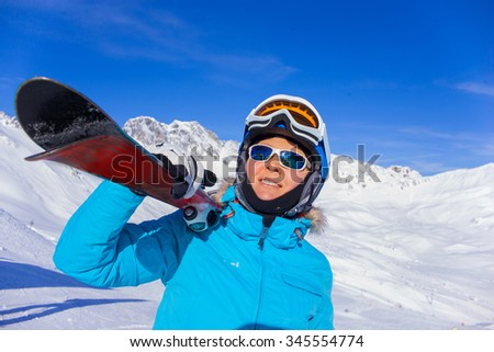 Portrait of Woman On the Ski in winter resort - stock photo