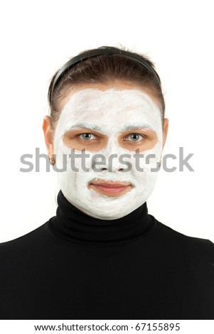 Portrait of  woman on white background doing cosmetic mask