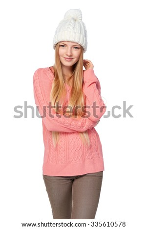 Portrait of woman on white background wearing warm winter clothing - stock photo