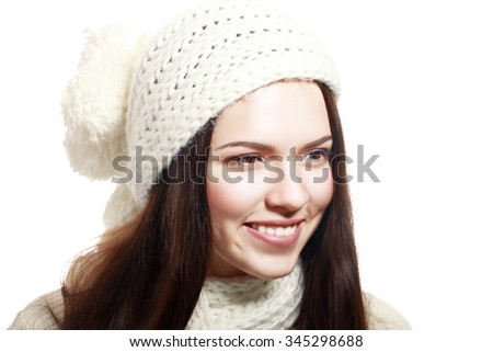 Portrait of woman on white background wearing woolen hat and sweater