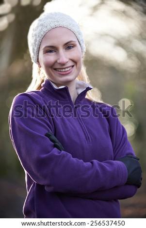 Portrait Of Woman On Winter Run Through Woodland - stock photo