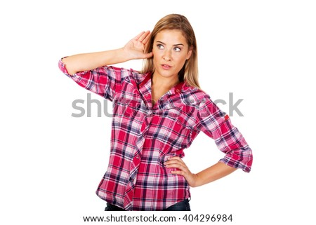 Portrait of woman overhearing a conversation - stock photo