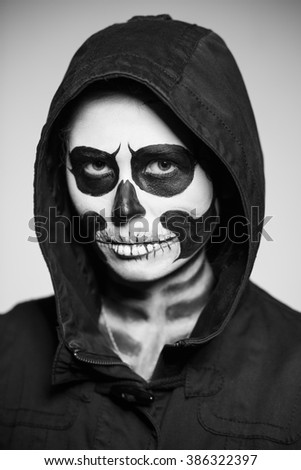 Portrait of woman painted like a corpse for Halloween. Monochrome