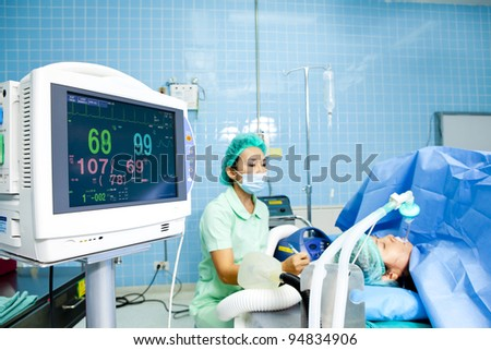 Portrait of woman patient receiving artificial ventilation in hospital - stock photo