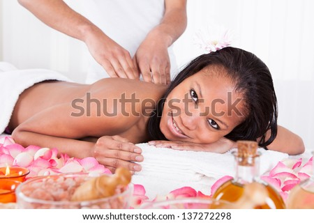 Portrait Of Woman Receiving Massage In Spa - stock photo