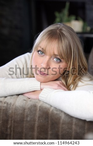 portrait of woman relaxing on the couch