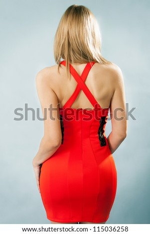 Portrait of woman's back with stylish red dress - stock photo