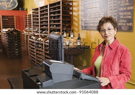 Portrait of woman selling wine - stock photo