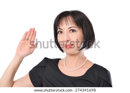 Portrait of woman showing stop hand gesture - stock photo
