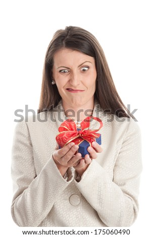 Portrait of woman showing unwanted gift isolated on white background. What is it? - stock photo
