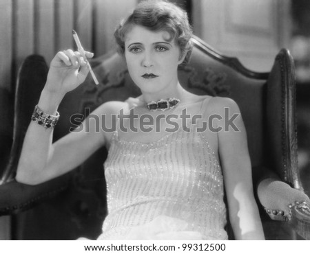 Portrait of woman smoking - stock photo