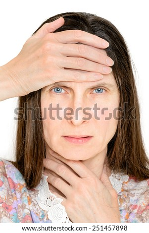 Portrait of woman suffering headache and laryngitis, probably flu or influenza. She keeps a hand on the throat and another on the forehead