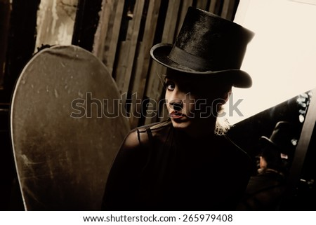 Portrait of Woman wearing a high hat closeup - stock photo