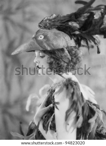 Portrait of woman wearing bird costume - stock photo