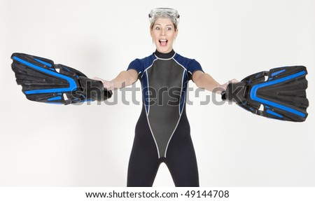 portrait of woman wearing neoprene with flippers and diving goggles - stock photo