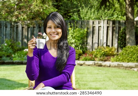 Portrait of woman with a cup of tea - stock photo