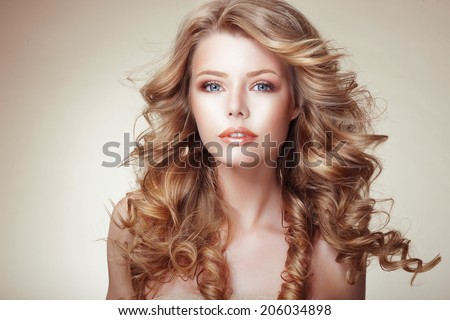 Portrait of Woman with Beautiful Flowing Bronzed Frizzy Hair - stock photo