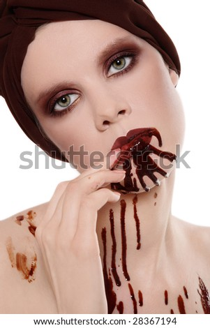 Portrait of woman with beautiful stylish makeup and chocolate on her face