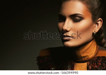 portrait of woman with brown accessory - stock photo