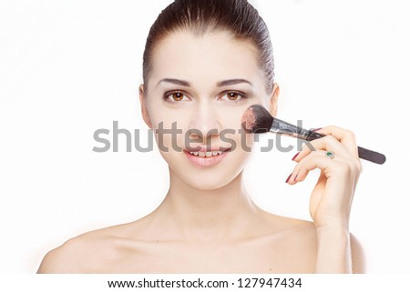 portrait of woman with brush for makeup
