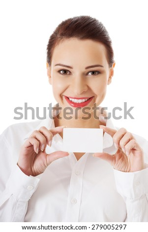 Portrait of woman with business card.