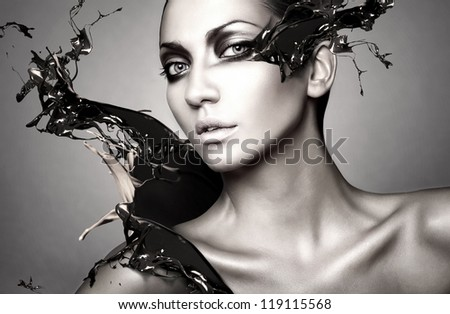portrait of woman with chocolate splash - stock photo