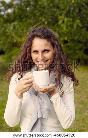 portrait of woman with coffee. Outdoor