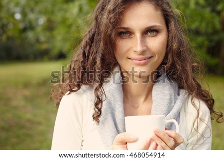 portrait of woman with coffee. Outdoor. Close-up