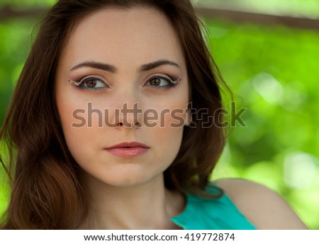 Portrait of woman with creative bridal makeup outdoors - stock photo