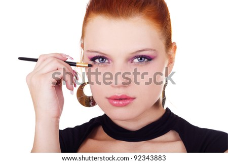 Portrait of woman with eyshadow brush isolated on white - stock photo