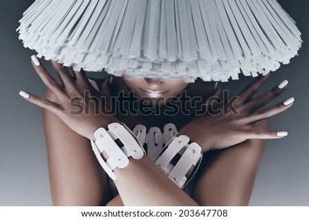 portrait of woman with face under white hat - stock photo