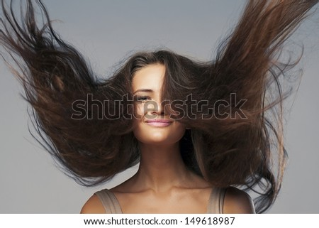 portrait of woman with flying hair