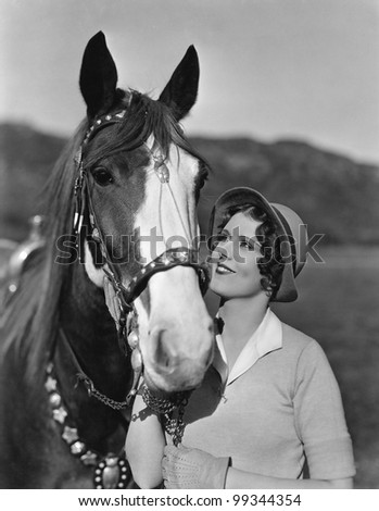 Portrait of woman with horse - stock photo