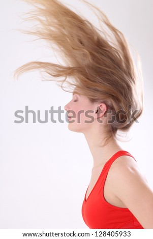 portrait of woman with long blowing hair over white